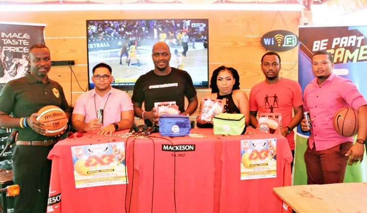 Members of the launch party pose for a photo opportunity following the official launch of the Mackeson/Rawle Toney 3x3 Basketball Classic at the Fireside Grill on Garnett Streets.