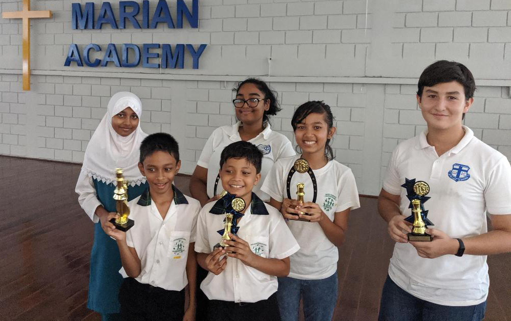 From left, Samirah Gobin, Secondary Schools champion, Angel Rahim, Best Female Secondary School player, Mahlia Rajkumar, Best Female Primary School player,  Luca Dotto, Secondary School runners-up, Arysh Raghunauth, Primary School winner and Mahir Rajkumar, Primary School runners up.