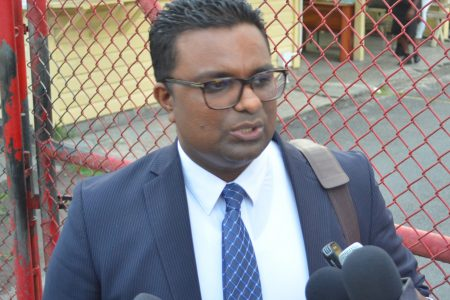 Commissioner Sase Gunraj speaks with media outside of GECOM's High Street Office (Photo by Orlando Charles).
