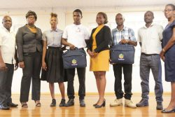From left are GITC Administrator Dexter Cornette, GITC Entrepreneurship Instructor Telitta Franklin, GITC competition participant Ornella Browne, Jameel Jacobs, Shamane Headley, Asante Waterton, who collected the grant on behalf of Collymore, competition participant Julius Cort and GITC Language and Communications Instructor Cheryl Ann Sam.