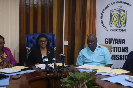 GECOM Chair Justice (ret'd) Claudette Singh addressing reporters at her first press conference yesterday, while being flanked by GECOM public relations officer Yolanda Ward (at left), Chief Election Officer Keith Lowenfield and Deputy Chief Election Officer Roxanne Myers. (Terrence Thompson photo)