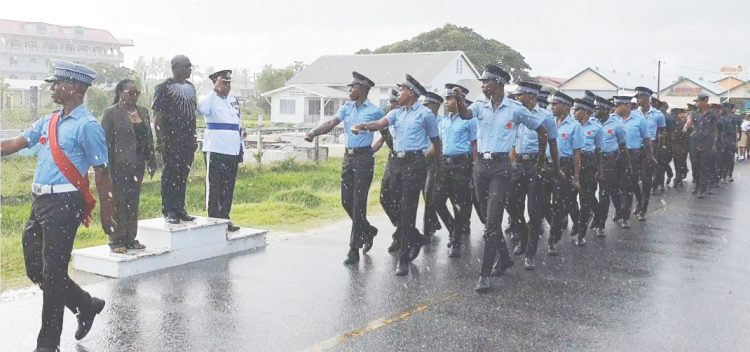 Scattered showers along the Essequibo Islands-West Demerara did not prevent the Regional Administration from its annual Remembrance Day observance at the Stewartville Monument Site on the West Coast of Demerara on Sunday. In photo: Members of the Guyana Police Force 'D' Division, taking the salute from Member of Parliament John Adams and Regional Executive Officer, Jennifer Ferreira-Dougall (left) and Commander Simon Mc Bean. (Department of Public Information photo)