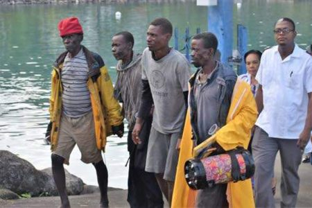 The four Haitian fishermen, who were rescued off the the coast of St Margaret's Bay in Portland yesterday, are seen here after being rehydrated. (Photo: Everard Owen)