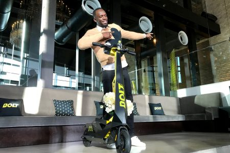 Usain Bolt posing for a photograph as he shows off an electric scooter at a launch event in Tokyo, Japan. — Reuters