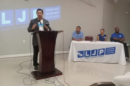 Lenox Shuman (standing) speaking at yesterday's press conference