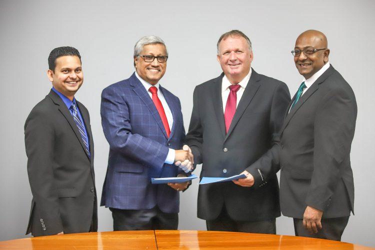 From left are DDL Finance Controller Vasudeo Singh, DDL Chairman Komal Samaroo, CWSL CEO Nigel Bennett and CWSL Chief Marketing Officer Darren Debideen (Demerara Offshore Incorporated photo)