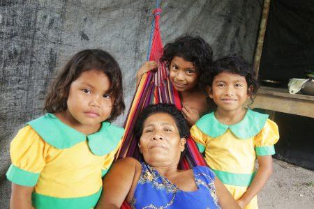 Anita Daniels surrounded by her granddaughters: Ferisa John, Leewana De La Cruz and Lena Daniels