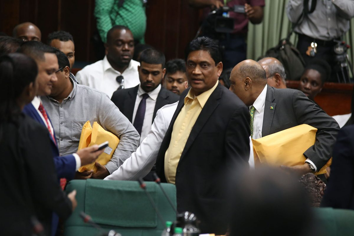 Former government MP Charrandass Persaud (at right in foreground) after his stunning vote in favour of the PPP/C's motion of no-confidence against the government. (Stabroek News file photo)
