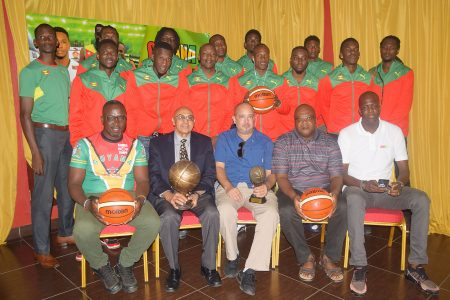 Members of the Grenada National Men's Basketball Team posing for a photo following their arrival on local shores. Also in the photo, sitting from left to right, are Guyana Head Coach Junior Hercules, GOA President Kalam Juman-Yassin, GABF President Michael Singh, Grenada Head Coach Naka Joseph and Grenada National Basketball Association Treasurer Rondell Johnson.