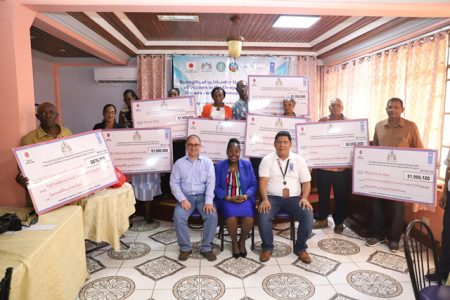 Recipients of UNDP's Micro-Grants. Also seated are UNDP Resident Representative, Jairo Valverde, Minister within the Ministry of Agriculture with responsibility for Rural Affairs Valerie Adams-Yearwood and Project Manager Jason Chacon. (DPI photo)