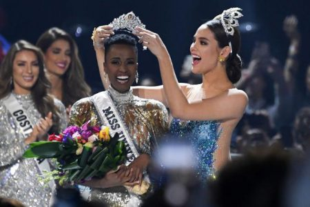 Miss Universe 2018 Catriona Gray of the Philippines crowns the new Miss Universe 2019, South Africa's Zozibini Tunzi, during the pageant at Tyler Perry Studios in Atlanta, Georgia, on December 8, 2019. (CNN photo) See page 18