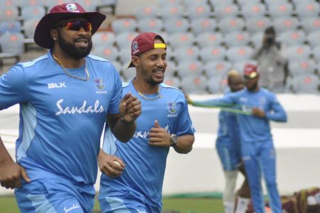 Captain Kieron Pollard (left) goes through his paces in a training session along with Lendl Simmons. (CWI photo)