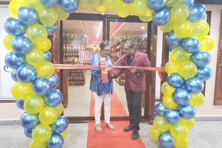 Beverley Harper (left) and Roy Beepat cutting the ribbon officially opening the Shoppe