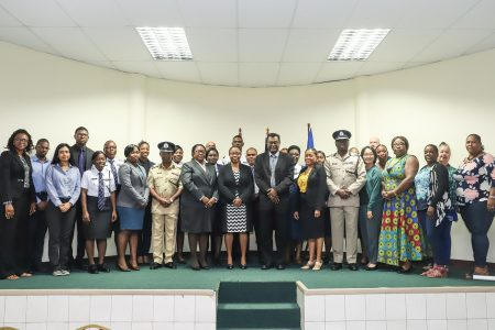 Public Security Minister Khemraj Ramjattan (seventh, from right) along with various stakeholders yesterday at the launching of the SOPs for the investigation and prosecution of TIP cases in Guyana.