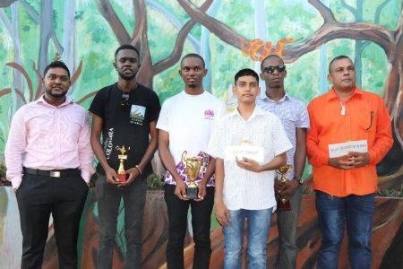 Manager of R. Sookraj and Sons Yuvindra Sookraj, Davion Mars, Anthony Drayton, Omesh Dyal, Wendell Meusa and Kriskal Persaud (Romario Samaroo photo)