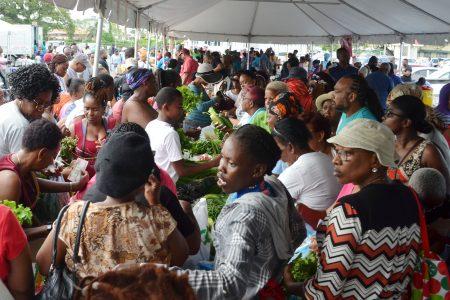 The crush at yesterday's Guyana Marketing Corporation's  D'Urban Park Farmers' Market. (Orlando Charles photo)