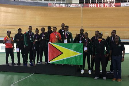 The Guyana contingent which participated at the just-concluded Caribbean Boxing Championships display their medals and the Guyana flag.