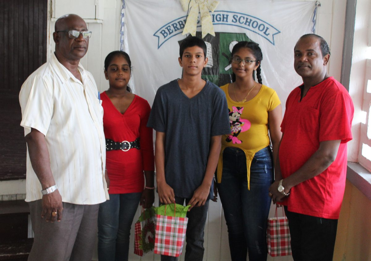 From left are Edward Anderson, Marissa, Pawan, Chitra and Basoodeo Utam