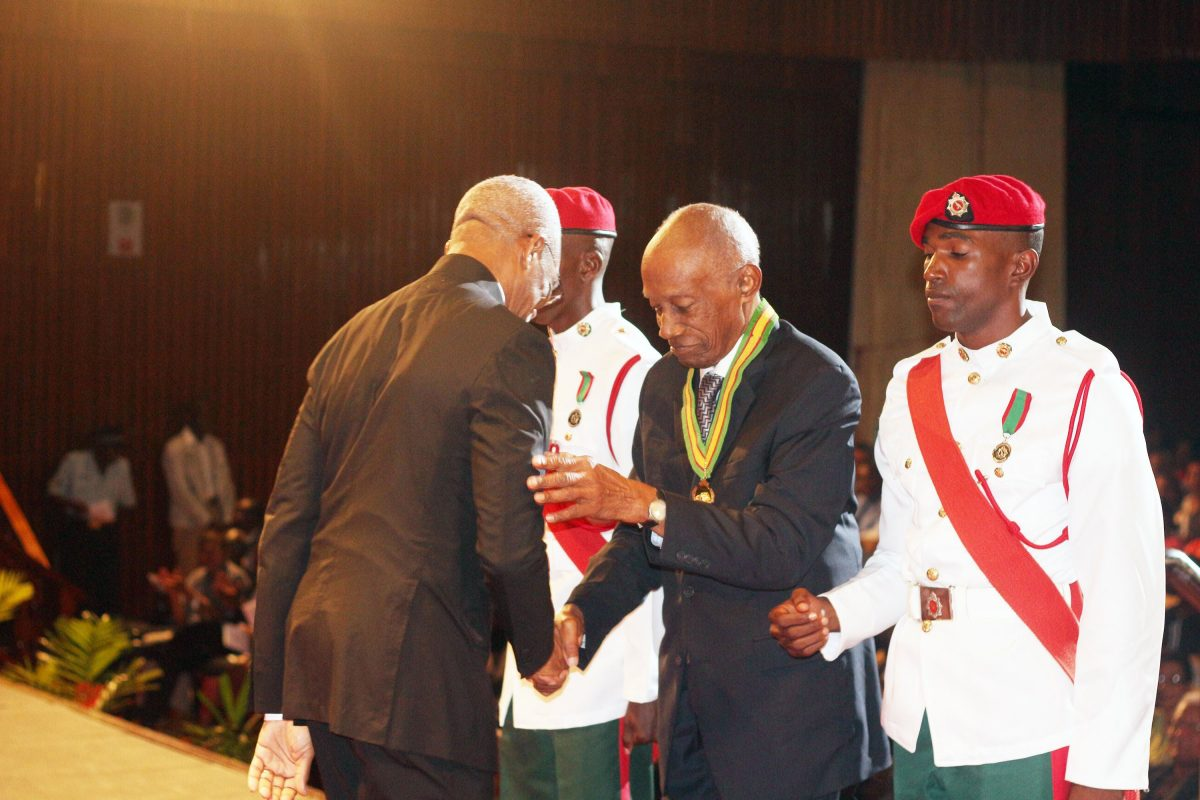 """President David Granger [left) in 2015 congratulating Bryn Pollard SC on his national award of the Order of Roraima for his """"contributions in the field of law at the National, Regional, Commonwealth and International levels."""""""