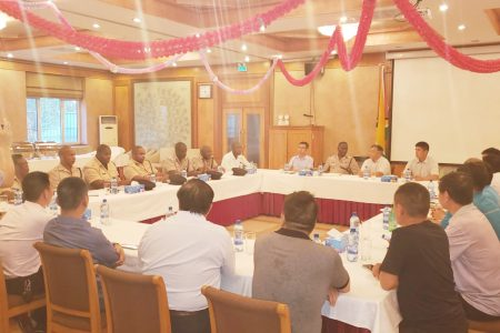 (In photo: Commissioner of Police Leslie James and the Divisional Commanders in discussion with members of the Chinese business community)