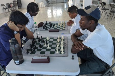 Ethan Lee (left) is a junior chess player who has been contesting the senior competitions during 2018. Here he faces Glenford Corlette who represented Guyana at a previous Chess Olympiad. Lee is a much-improved contender and is expected to perform creditably in the qualifier for the 2020 National Chess Championship. (Photo by John Lee)