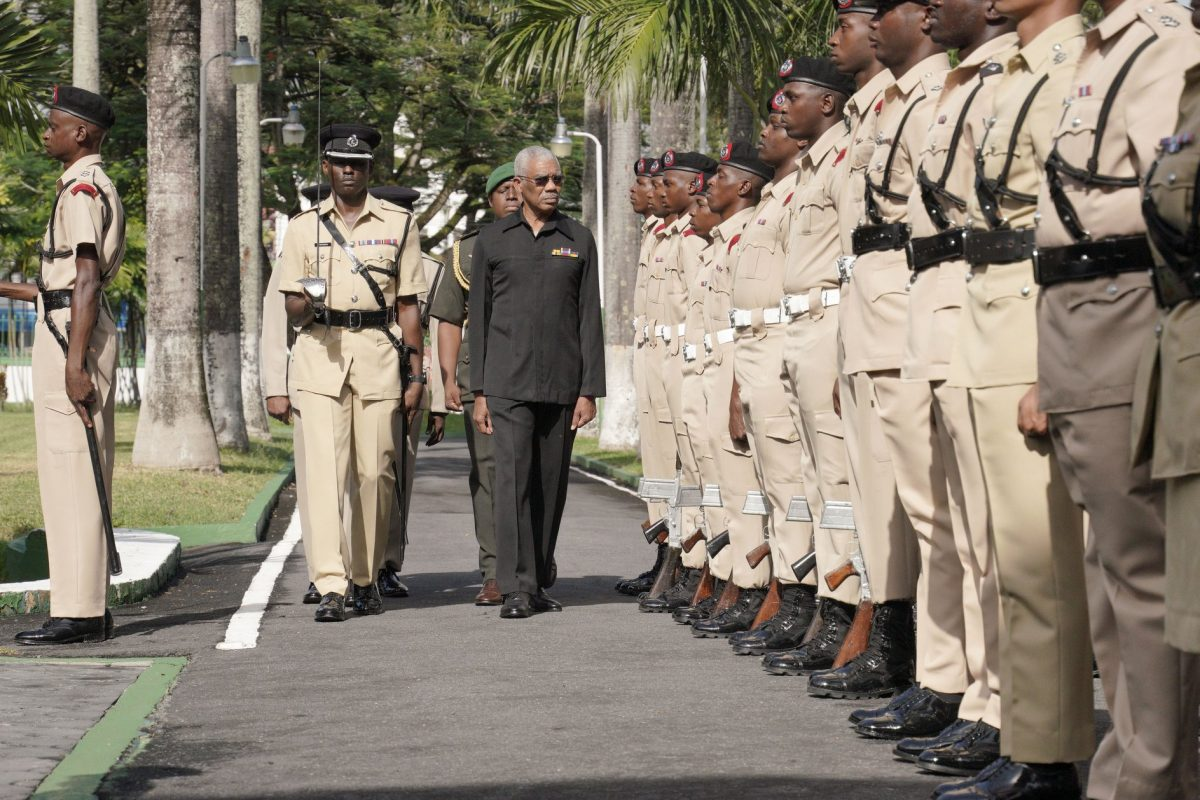 President David Granger inspecting the guard of honour this morning. [Ministry of the Presidency photo)
