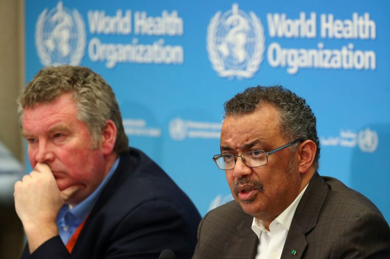 Director-General of the World Health Organization [WHO) Tedros Adhanom Ghebreyesus speaks next to Michael J. Ryan, Executive Director of the World Health Organization (WHO) Health Emergencies Programme during a news conference after a meeting of the Emergency Committee on the novel coronavirus (2019-nCoV) in Geneva, Switzerland January 30, 2020. REUTERS/Denis Balibouse