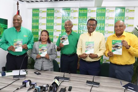 President David Granger (at centre) with running mate Khemraj Ramjattan (second, from right) and other APNU+AFC officials at the launch of the incumbent coalition's manifesto yesterday (Department of Public Information photo)
