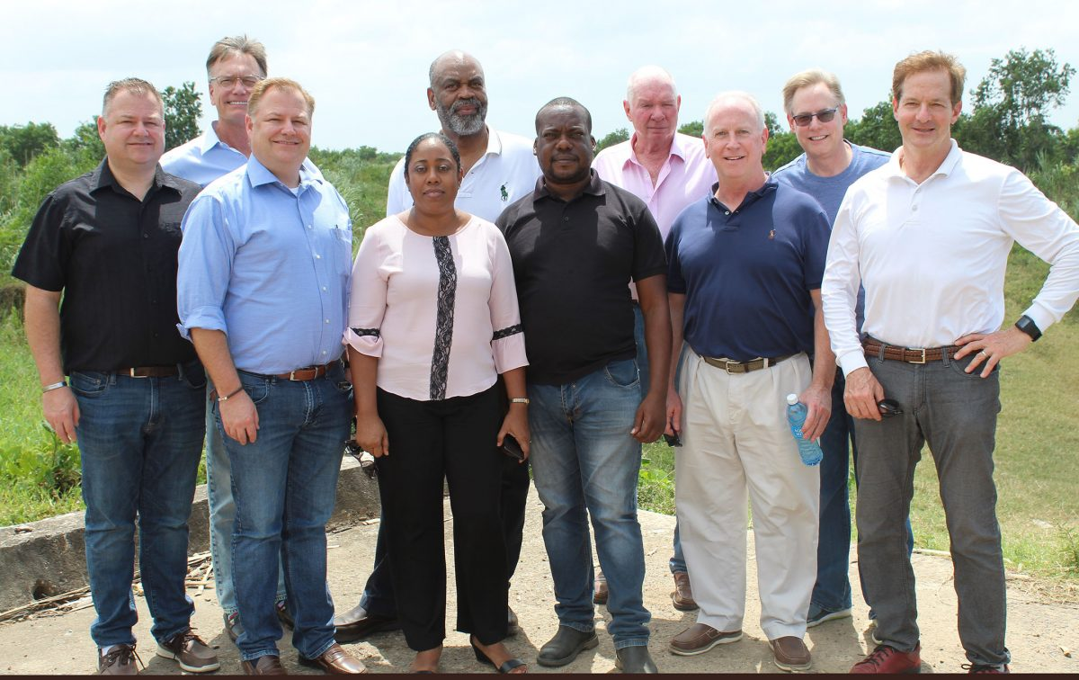 US-based businessman Edmond Braithwaite [5th from left) and some of the members of an investment team he recently brought here. Mike Elliott is 3rd from left.