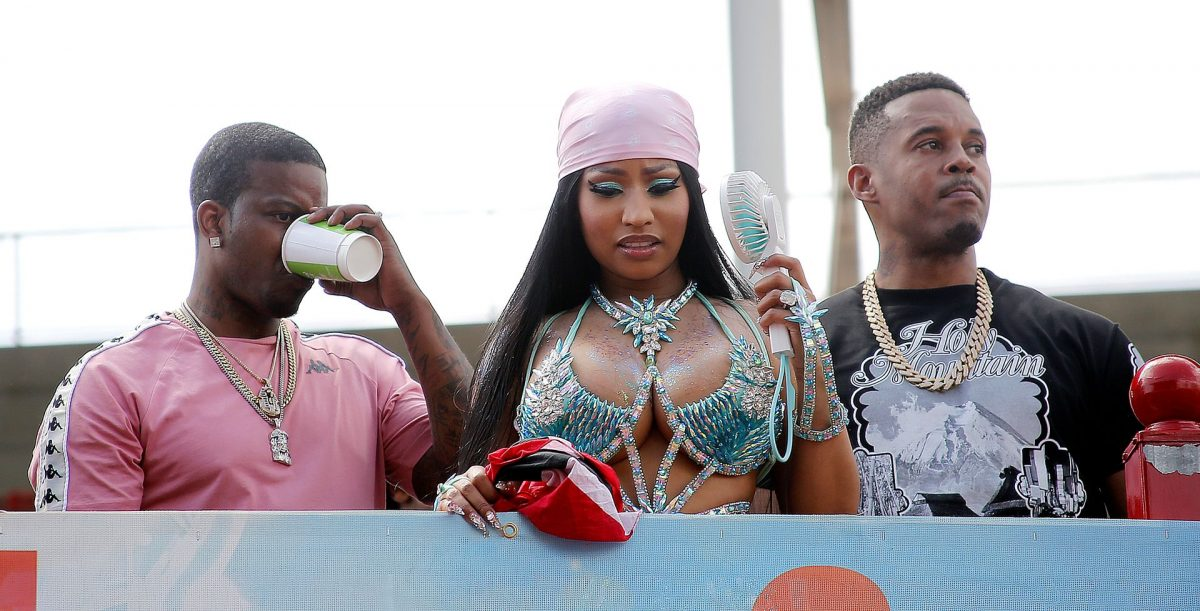 Hip hop artiste Nicki Minaj aboard a Tribe truck looks at masqueraders during the Parade of Bands at the Socadrome, Hasely Crawford Stadium, on Tuesday.