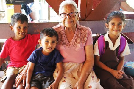 Pohmatie Moosai with her great grandsons Shane and Sid and their friend Ania Ramdeen of Mortice Primary School