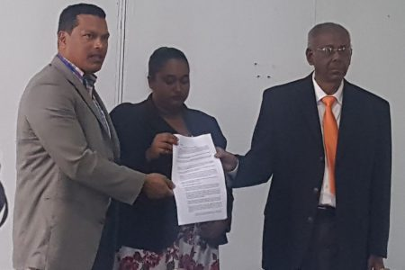 From left are Liberty and Justice Party (LJP) leader and presidential candidate Lenox Schuman, The New Movement (TNM) presidential candidate Dr Asha Kissoon and ANUG presidential candidate Ralph Ramkarran with the signed agreement.