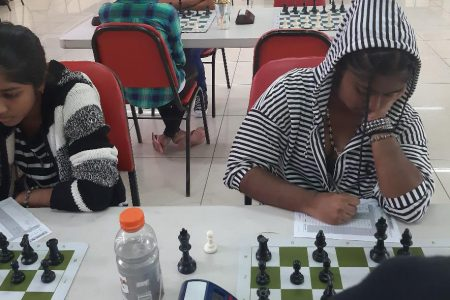 The Gobin sisters, Samirah (left) and Suriyah, playing alongside each other at the Ladies Olympiad Chess Championship, which was conducted recently at the National Stadium, Providence. Samirah placed second in the Championship and qualified to represent Guyana at the 2020 Chess Olympiad in Russia. She is a Grade 10 student of the Al-Ghazali Islamic Academy School. Her sister Suriyah, is a first-year computer science student at the Government Technical Institute, Georgetown.  (Photo by Bibi Gobin)