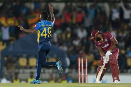 West Indies skipper Kieron Pollard is bowled all ends up by Wanindu Hasaranga as the West Indies suffered a heavy defeat in the second ODI yesterday to lose the series.