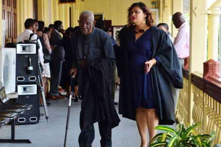 Senior Counsel Llewellyn John (left) at the High Court on Wednesday for the ruling in the case before Chief Justice Roxane George for the verification of Region Four votes. At right is PPP executive Priya Manickchand.