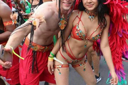 Foreigners enjoying carnival in Guyana.