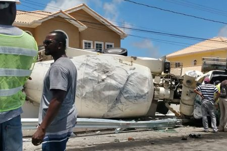 A cement truck toppled around midday yesterday along the Happy Acres, East Coast Demerara Public Road. Sunday Stabroek was told that the truck, bearing licence plate GVV 301, was proceeding east along the public road when the driver reportedly lost control while negotiating a turn. No fatality was reported. However, the driver was said to be seriously injured. He was rescued by public-spirited citizens and taken to the hospital.