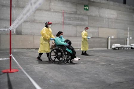 Coronavirus patients arrive at a military hospital set up at the IFEMA conference centre in Madrid, Spain, March 21, 2020. Picture taken March 21, 2020. Comunidad de Madrid/Handout via REUTERS