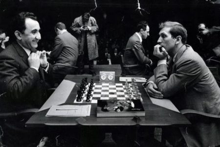 Russian chess grandmaster Tigran Petrosian (left) and the USA's Bobby Fischer before the start of their game in the USSR vs Rest of the World match in Belgrade, Yugoslavia, in April 1970. The USSR won by a one-point margin, 20½ to 19½. Fischer defeated Petrosian twice and drew his other two games. (Photo: Chessbase)