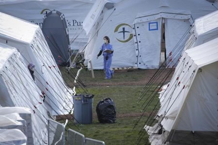 A healthcare worker walks outside a newly constructed field hospital in the East Meadow of Central Park during the outbreak of the coronavirus disease (COVID-19) in the Manhattan borough of New York City, New York, U.S., April 1, 2020. REUTERS/Brendan Mcdermid