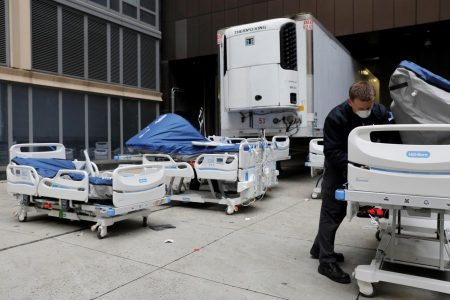 A worker inspects part of a delivery of 64 hospital beds from Hillrom to The Mount Sinai Hospital during the outbreak of the coronavirus disease (COVID-19) in Manhattan, New York City, U.S., March 31, 2020. REUTERS/Andrew Kelly