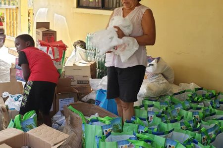 Stephanie Fraser preparing the first set of hampers that were expected to arrive in Santa Rosa yesterday