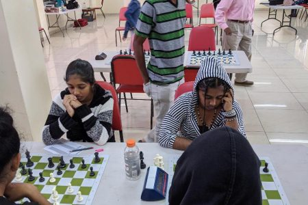 Samirah Gobin (at left) is one of Guyana's representatives for the 2020 Chess Olympiad. Samirah will play in the Women's section on Board Two. On her left is her sister Suriyah. The photo was taken during the last National Women's Chess Championship.