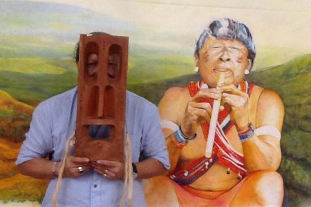 Late artist George Simon with one his paintings