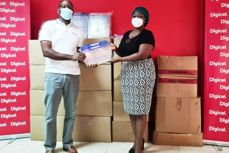 Digicel's CEO Gregory Dean and Viola Rowe who was performing duties for the Chief Education Officer at the handing over