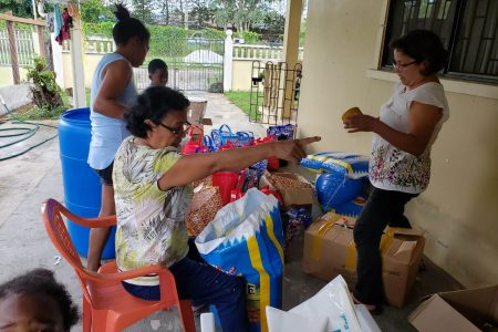 The Santa Rosa Family Group members packing the relief hampers