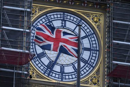 The Union flag flutters near the clock face of Big Ben during ongoing renovations to the Tower and the Houses of Parliament, in central London. (Photo: AP)