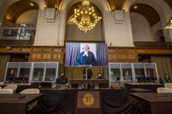 An International Court of Justice photo from yesterday's proceedings at The Hague showing Sir Shridath Ramphal making his presentation remotely.