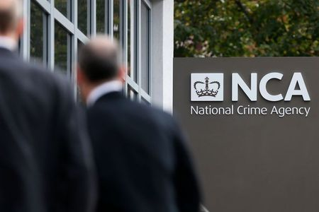 FILE PHOTO - Pedestrians walk past the National Crime Agency (NCA) headquarters in London October 7, 2013. REUTERS/Stefan Wermuth