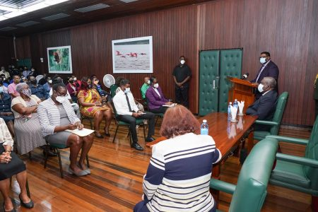 President Irfaan Ali yesterday addressing the Heads of Department of the Ministry of the Presidency as Prime Minister Brigadier (Ret'd) Mark Phillips and Minister of Parliamentary Affairs, Gail Teixeira look on.   (Ministry of the Presidency photo)